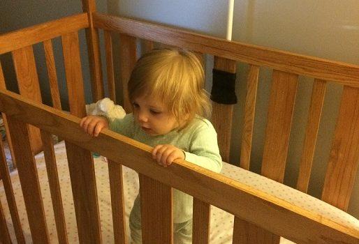 Girl in a Crib before sleep