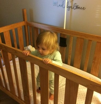 Girl in a Crib before sleep